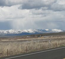 Last Snow Storm over Tool Mountain? by Dave Sandersfeld