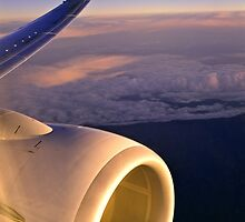 Flying high - Jet engine & wing by graphicscapes