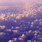 Aerial Cloudscape at 30,000 feet by graphicscapes