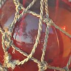 Orange Glass Ball in Rope by Rena Neal