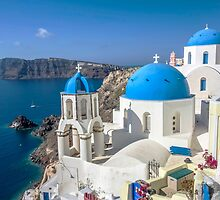 Blue and white church in Santorini by ibphotos