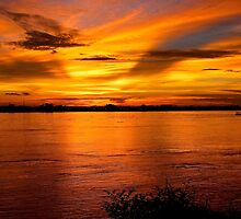Bright Red Sunset - Thakhek, Laos. by Tiffany Lenoir