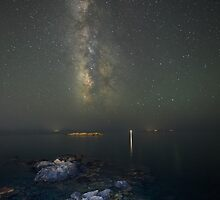 Milky way at a rocky sea coast in Syros island, Greece by Antonis Lemonakis