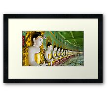 Buddhas and wall in temple Framed Print