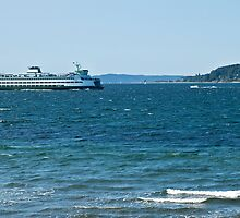 A car/passenger ferry on Elliott Bay heads toward downtown Seattle piers. by Barb White