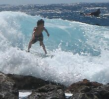 Young Surfer at Pohoiki by ronholiday