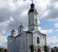 White church and clouds by branko stanic