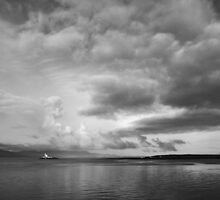 Moody ominous sky with lighthouse by Paul Woods