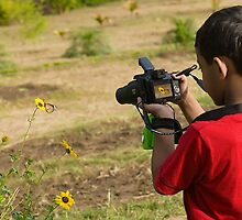 The Photographer and the Butterfly by Mukesh Srivastava