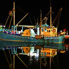 Lakes Entrance Fishing Boats (At night) by John Vandeven