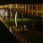 Lakes Entrance Bridge leading to the sea. by John Vandeven