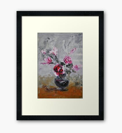Roses in black vase Framed Print