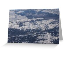 Flying Over the Snow Covered Rocky Mountains Greeting Card