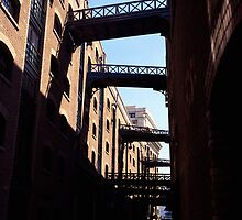 The 'Canyon' of Shad Thames in London. by Peter Stone