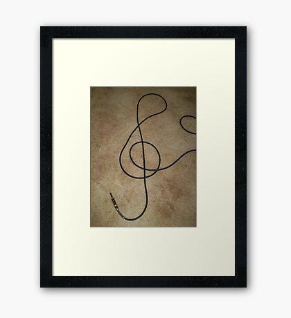 treble clef. Framed Print