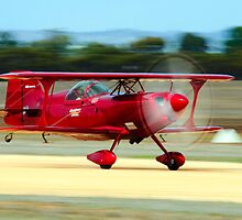 Zooming down the runway for take off by Nuttee Ratanapiseth