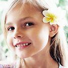 Girl And Frangipanis Flowers by Evita