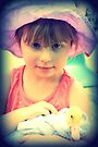 Little Girl Holding A Duck by Evita