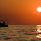 Sunset with small yacht. by Wildcat123