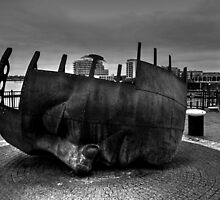Face Sculpture At Mermaid Quay Cardiff Wales by Ian Mooney