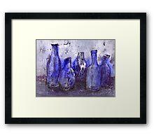 blue bottles Framed Print