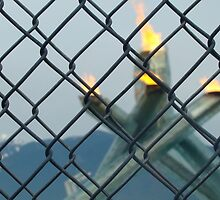 vancouver cauldron behind wired fence by JamesRoberts