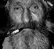 old man with a cigarette by Igor Philipenko