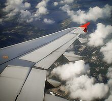 Outside the window of a plane by Laura Sanders