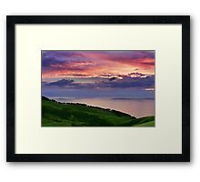 Sunset over emerald hills Framed Print