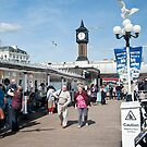 Seagull's Landing at Noon on Brighton Pier: East Sussex, UK.  by DonDavisUK