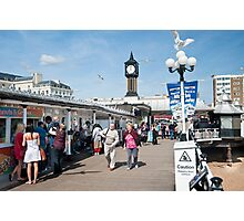 Seagull's Landing at Noon on Brighton Pier: East Sussex, UK.  Photographic Print