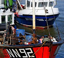 Fishing boats, West Bay Harbour, Dorset, UK by buttonpresser