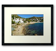 Mediterranean beach with rocks and sand in Spain Framed Print