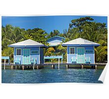 Two blue cabins over water with coconut trees Poster