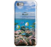 Boat above a coral reef with shoal of fish underwater iPhone Case/Skin