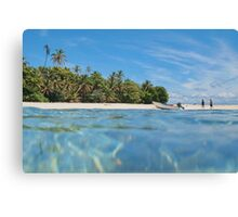 Caribbean island with boat on the beach Canvas Print