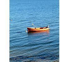 Orange boat on blue water Photographic Print