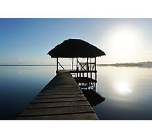 Dock with tropical hut over water on sunrise light Photographic Print