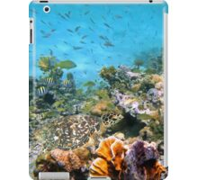 Sea turtle in a coral reef with shoal of tropical fish iPad Case/Skin