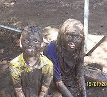 Kids in mud by Bernie Stronner