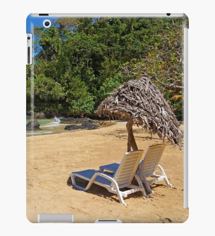 Lounge chairs with parasol on tropical beach iPad Case/Skin