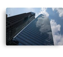Sky and Sky - Toronto Skyscraper Reflecting Fluffy White Clouds Canvas Print