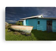Boat and hut Canvas Print