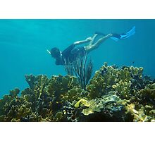 Man underwater snorkeling over a coral reef Photographic Print