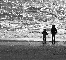 Figures on Chesil Beach Dorset by Paul Pasco