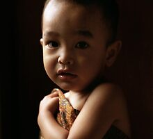 a boy in a batik fabric by irenaeus herwindo