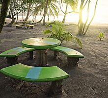 Sunset on beach with round table and benches by Dam - www.seaphotoart.com
