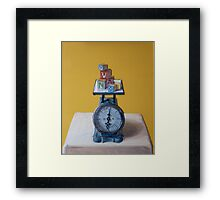 Weighing Education Framed Print