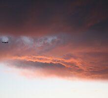 Airplane through sunset by YasLalu
