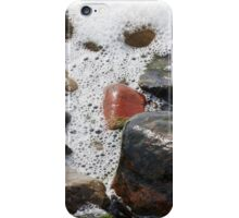 Colorful stones washed by the foaming water on the beach iPhone Case/Skin